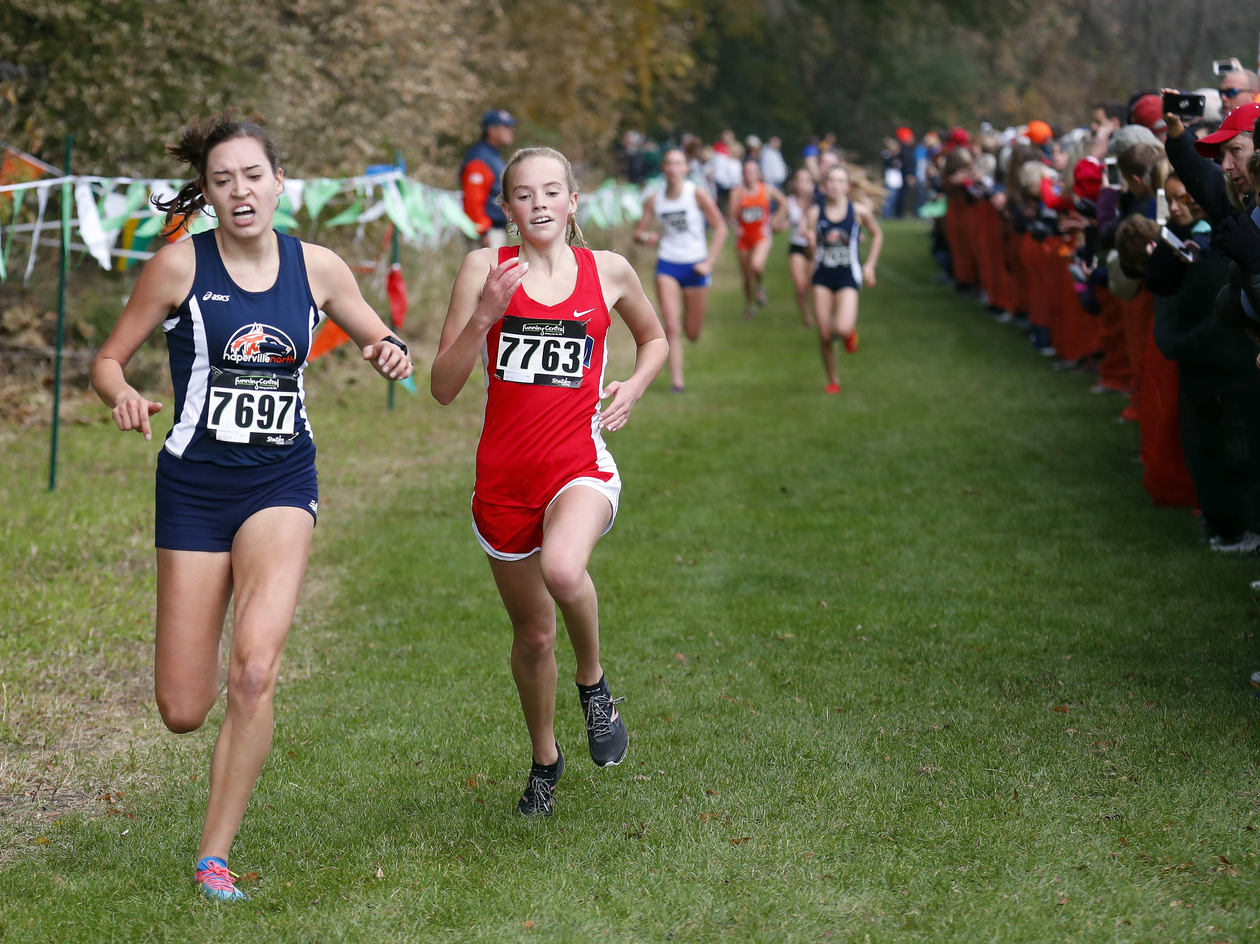 Campbell Petersen of Naperville North and Naomi Ruff of South Elgin Saturday during the Waubonsie Valley cross country sectional in Aurora.