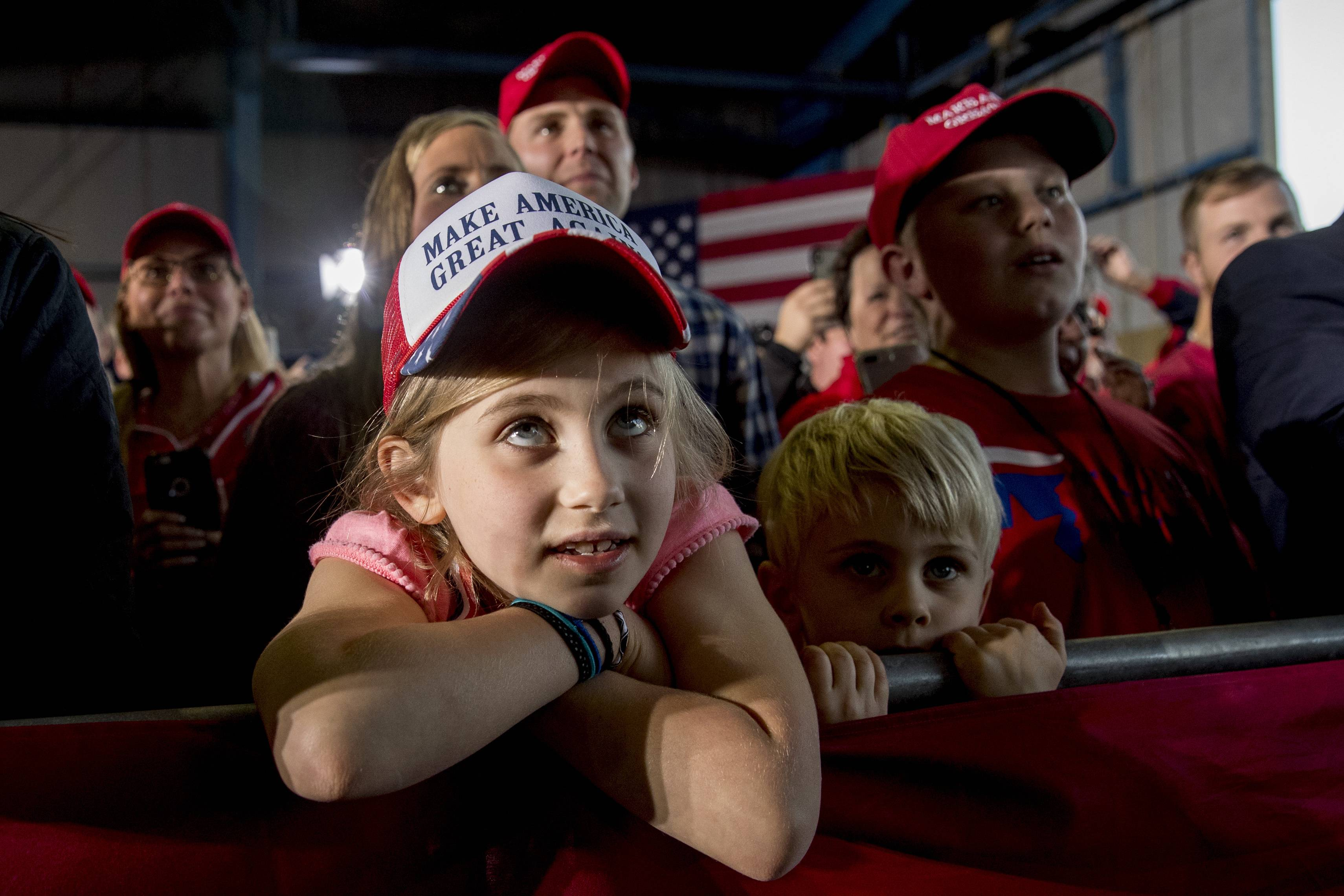 Children in the audience listen as President Donald Trump speaks at a rally at Southern Illinois Airport in Murphysboro, Ill., Saturday.