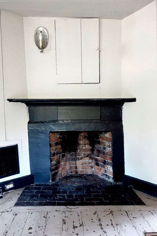 The central fireplace in the kitchen of the James Blake House. Cole is restoring the home's interior to make it more livable for current caretaker Barbara Kurze.
