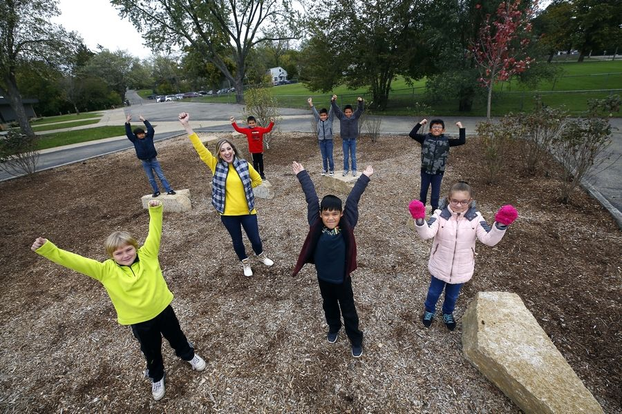 A group of students from Round Lake Beach Elementary School initiated a plan to make the school's outdoor area nicer. From left to right are, back row, Alexander Castro-Gomez, Cristian Valadez, Luis Flores and Angel Rivas-Cruz; middle row, teacher Annie Adamski and Samuel Dos-Santos; and, front row, Christopher Verjinski, Mateo Rodriguez and Nancy Tellez.