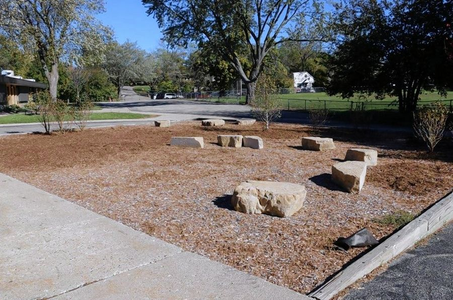 Work crews removed an old jungle gym at Round Lake Beach Elementary School and replaced it with vegetation and boulders for students to sit on.