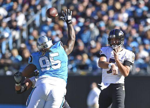 0856a4a30 Baltimore Ravens' Joe Flacco (5) throws a pass over Carolina Panthers'  Dontari