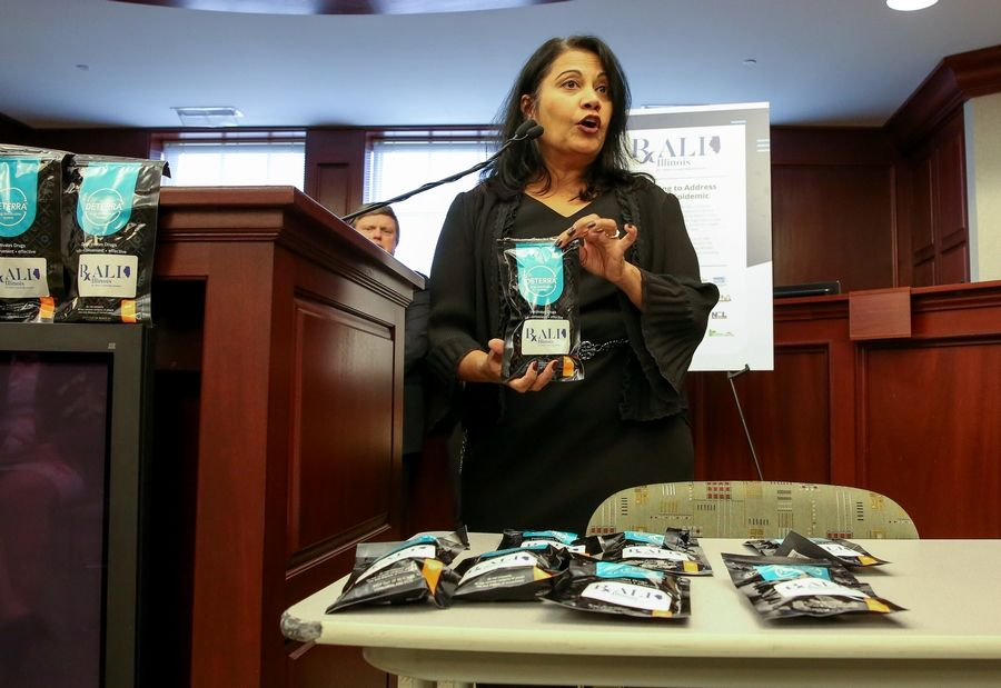 Shweta Adyanthaya, vice president of marketing and communications for the Community Anti-Drug Coalitions of America, demonstrates ways to dispose of unwanted prescriptions Tuesday in Deerfield as officials launch the new the Rx Abuse Leadership Initiative of Illinois.