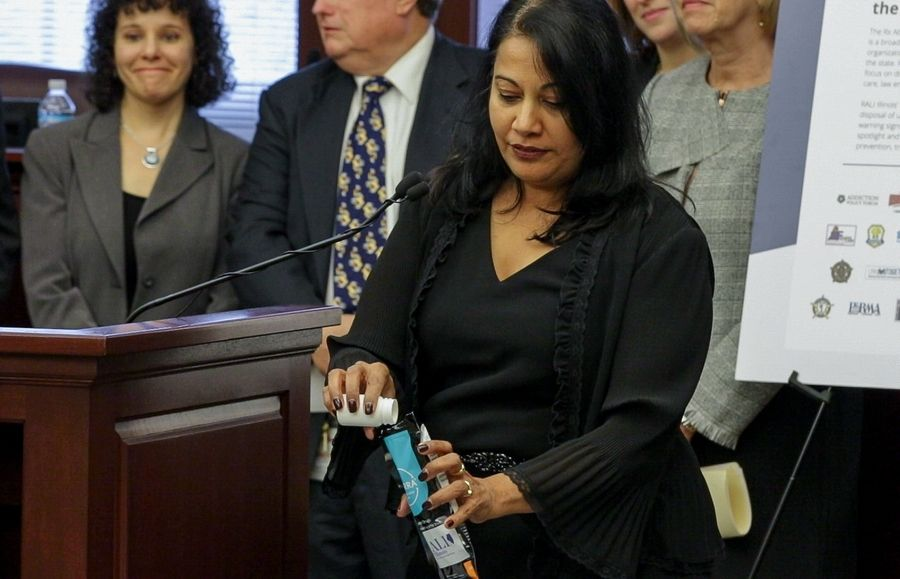Shweta Adyanthaya, vice president of marketing and communications for the Community Anti-Drug Coalitions of America, shows how to use one of the drug disposal pouches soon to be given out free across the state by a new organization called Rx Abuse Leadership Initiative of Illinois.
