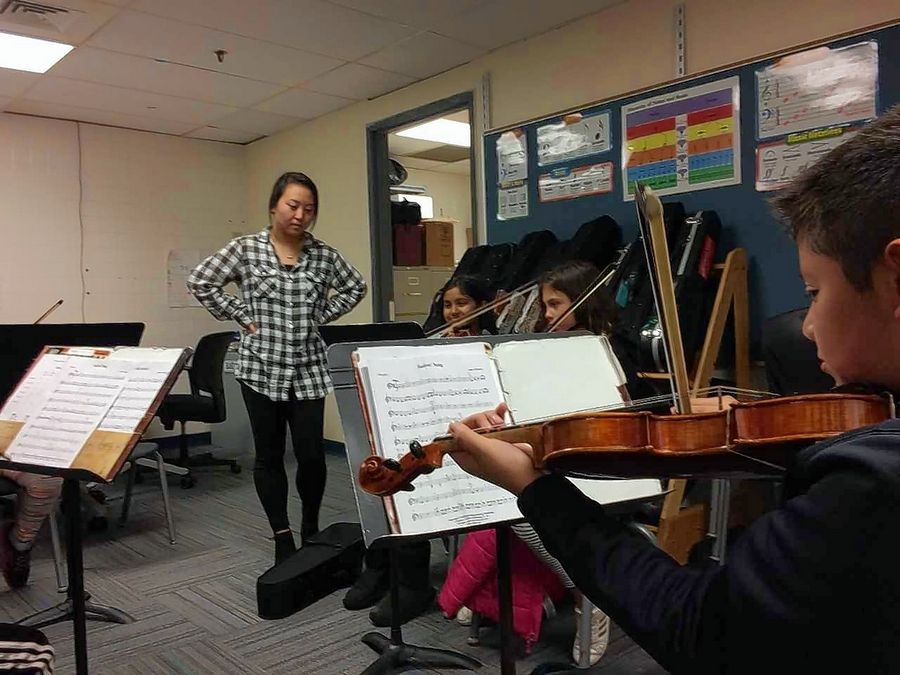 Haemi Lee teaches fifth-grade orchestra students at Hawthorn Elementary South, where a space crunch means students practice in a converted kitchen.