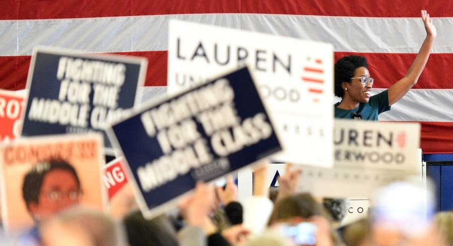 14th District congressional candidate Lauren Underwood greets the crowd at a rally at the Kane County Fairgrounds Wednesday. Former Vice President Joe Biden was there to endorse her.