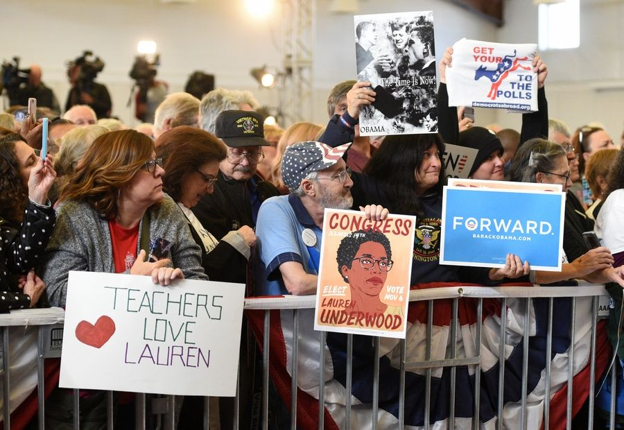 Lauren Underwood supporters watch her speak at the Kane County Fairgrounds in St. Charles Wednesday.