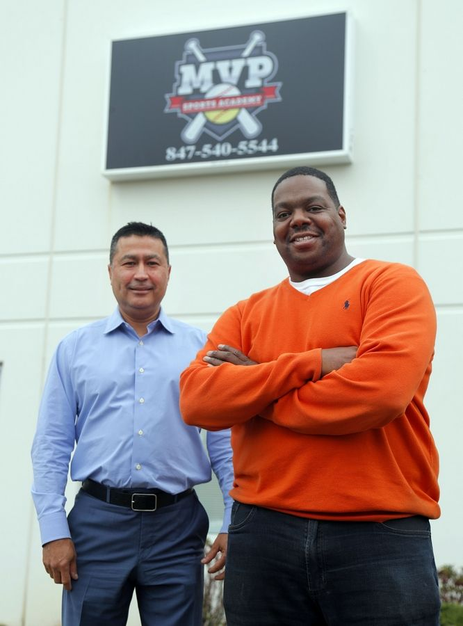 Arturo Saenz, left, and Wil Benjamin are the co-owners of MVP Sports Academy in Lake Zurich. They are hosting a grand opening Saturday.
