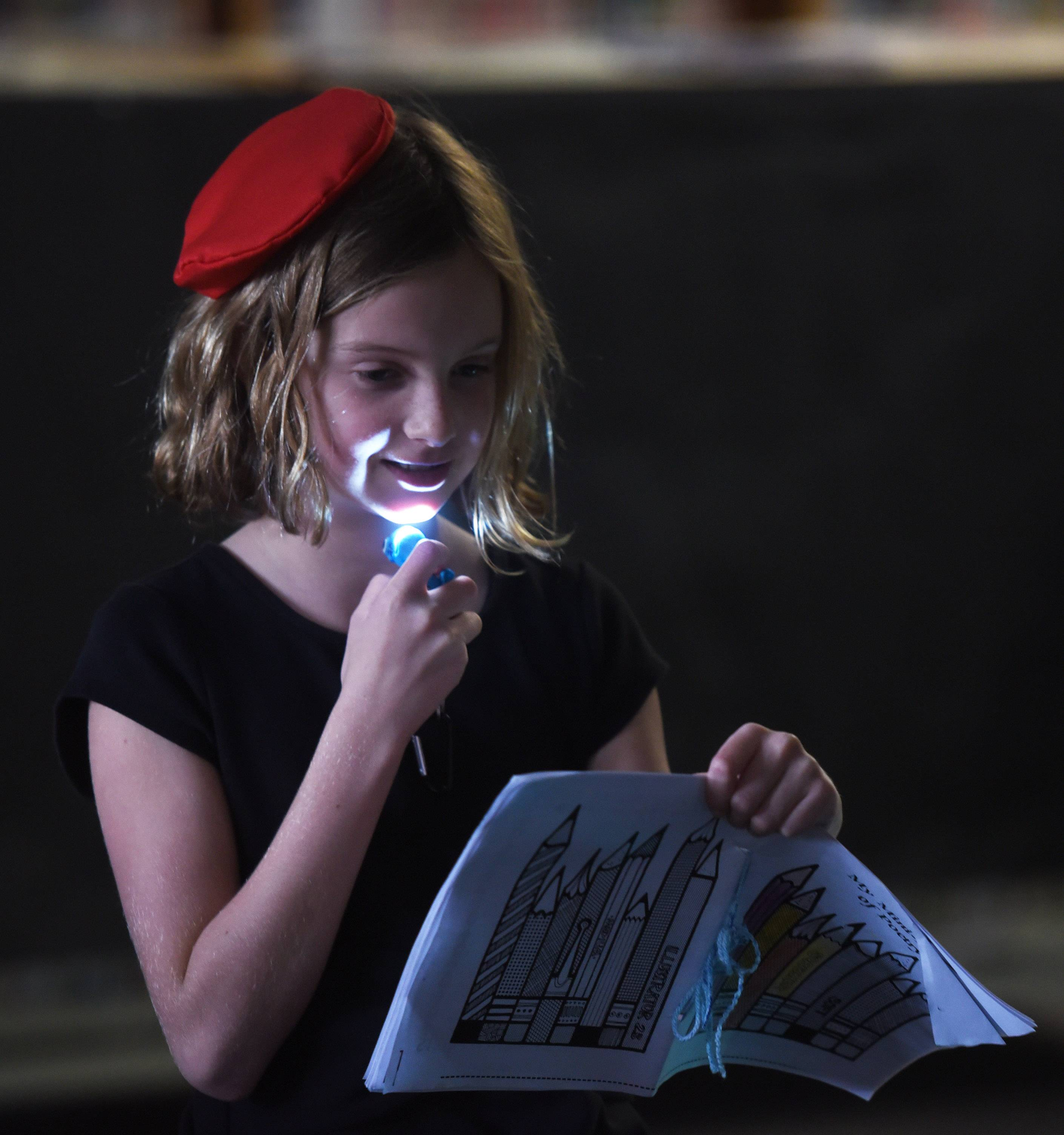 Maddie Cook shares a poem during the Anonymous Poets Society poetry and jazz slam by fourth-grade students at Hammerschmidt Elementary School in Lombard.