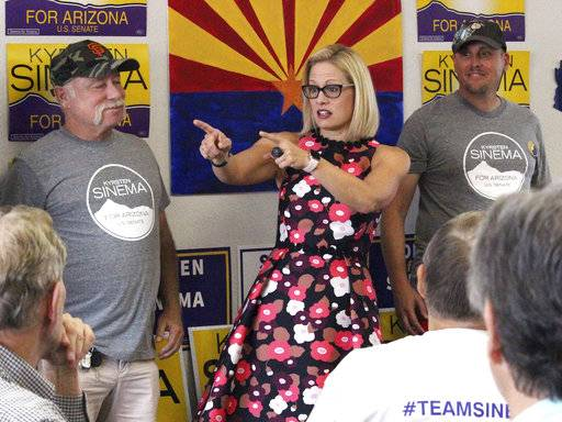 "Democratic Senate candidate Kyrsten Sinema talks to volunteers at a get-out-the-vote phone bank in Phoenix, Ariz., alongside members of the ""Veterans for Sinema"" group in this Thursday, Nov. 1, 2018 photo. Both major parties are worrying about so-called ""spoilers� as election day nears. In tight races, third party candidates can make the difference by drawing away voters who'd otherwise support the Democrat or Republican."