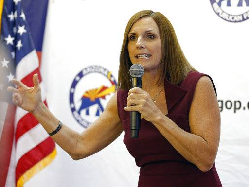 "Rep. Martha McSally, R-Ariz., speaks at a campaign rally, Thursday, Nov. 1, 2018, in Sun City, Ariz. McSally is running against Democrat Krysten Sinema for the U.S. Senate. Both major parties are worrying about so-called ""spoilers� as election day nears. In tight races, third party candidates can make the difference by drawing away voters who'd otherwise support the Democrat or Republican."