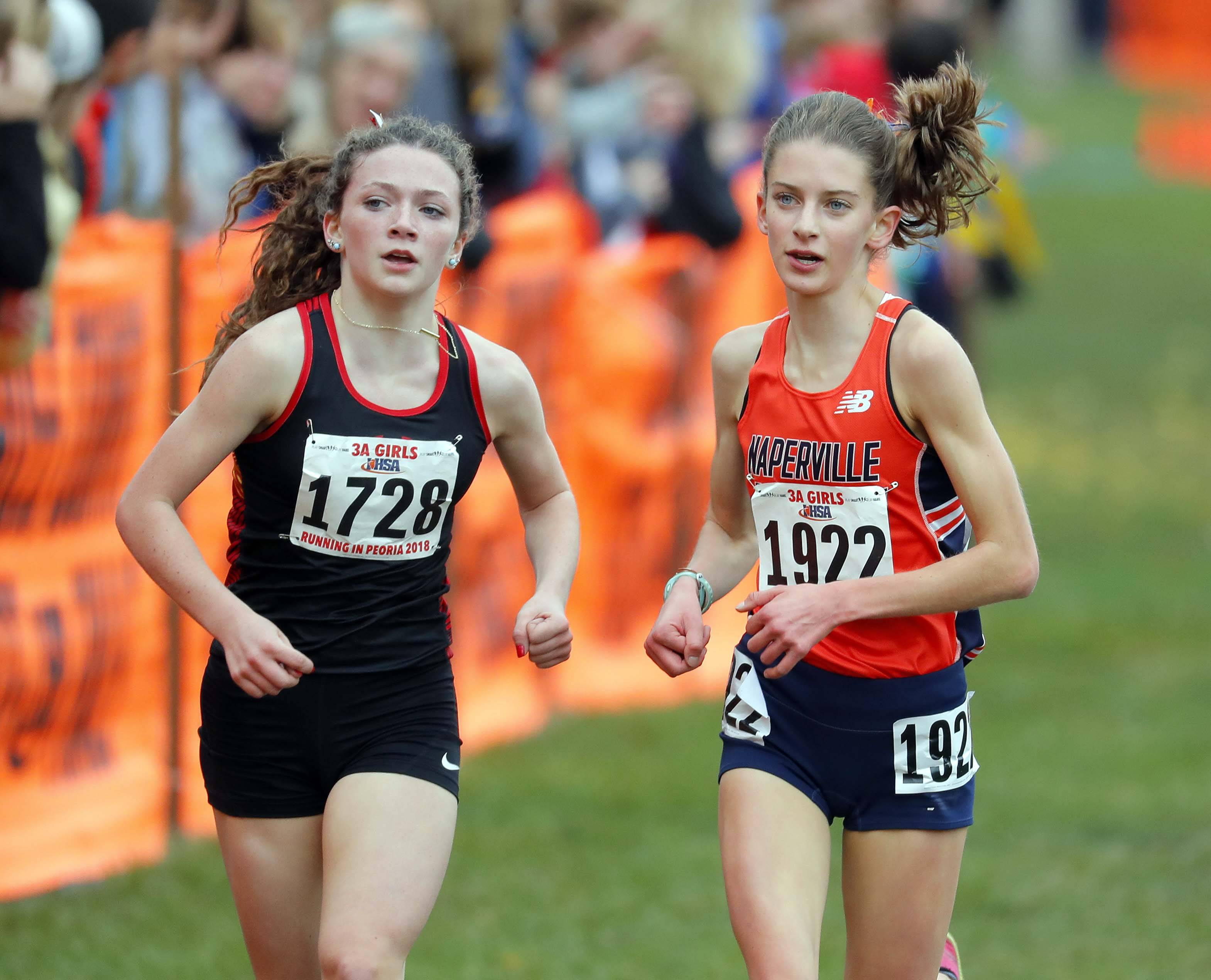 Batavia's Katrina Schlenker, left, and Naperville North's Alex Morris race to the finish at the Class 3A state meet.