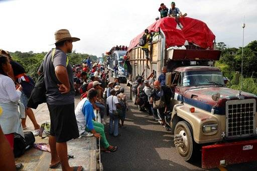 Central American migrants, part of the caravan hoping to reach the U.S. border, get a ride on trucks, in Donaji, Oaxaca state, Mexico, Friday, Nov. 2, 2018. The migrants had already made a grueling 40-mile (65-kilometer) trek from Juchitan, Oaxaca, on Thursday, after they failed to get the bus transportation they had hoped for. But hitching rides allowed them to get to Donaji early, and some headed on to a town even further north, Sayula.