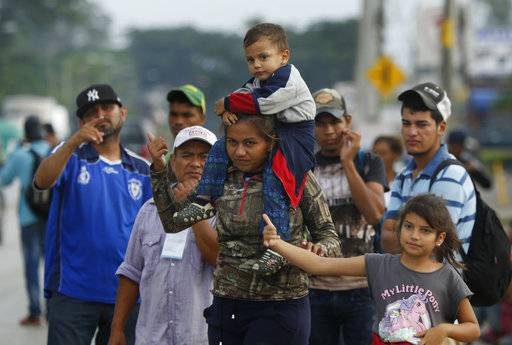 Central American migrants, part of the caravan hoping to reach the U.S. border, ask for a ride as they hitch hike in Donaji, Oaxaca state, Mexico, Friday, Nov. 2, 2018. The migrants had already made a grueling 40-mile (65-kilometer) trek from Juchitan, Oaxaca, on Thursday, after they failed to get the bus transportation they had hoped for. But hitching rides allowed them to get to Donaji early, and some headed on to a town even further north, Sayula.