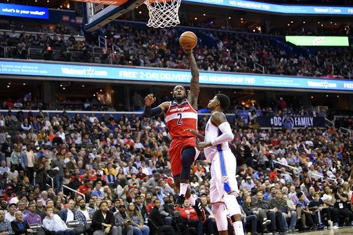 Washington Wizards guard John Wall (2) goes to the basket against Oklahoma City Thunder forward Paul George during the second half of an NBA basketball game Friday, Nov. 2, 2018, in Washington.