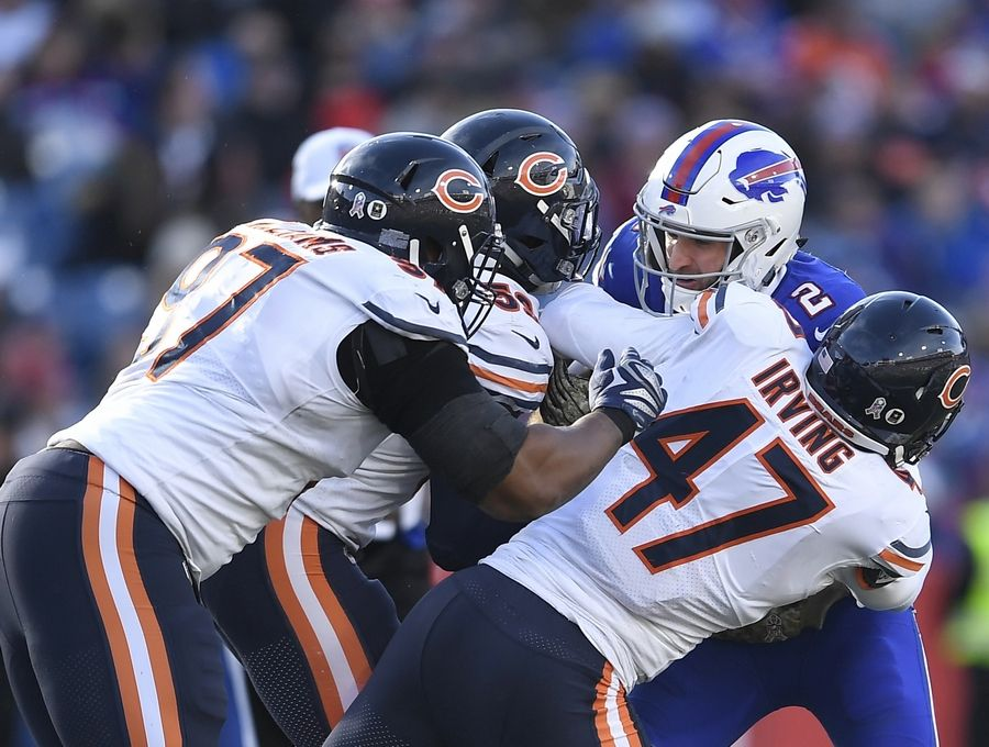 Buffalo Bills' Nathan Peterman (2) is sacked by Chicago Bears' Isaiah Irving (47) and Nick Williams (97) during the second half of an NFL football game Sunday, Nov. 4, 2018, in Orchard Park, N.Y.