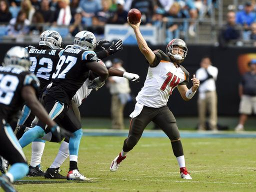 0f360d75 Tampa Bay Buccaneers' Ryan Fitzpatrick (14) throws a pass under pressure  from Carolina