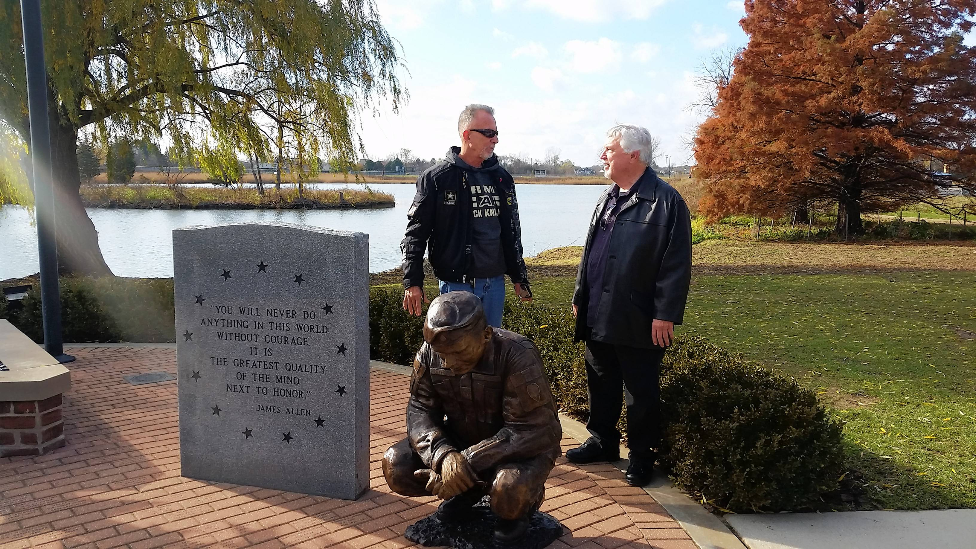 Wayne J. Maczko, a retired CLC HVAC engineer and veteran, left, and sculptor Gary Tillery discuss statues honoring U.S. military veterans that were dedicated at the College of Lake County in Grayslake Monday.