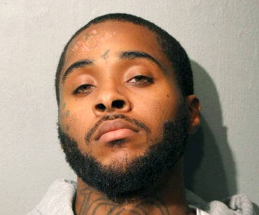 This undated photo provided by the Chicago Police Department shows Christopher Carter. Carter was wanted for weeks for a crash that killed a boy and two men in Chicago. Police say Christopher Carter was arrested Friday, Nov. 2, 2018,  a month after fleeing on foot in Chicago's Englewood neighborhood. He's charged with murder, reckless homicide and other crimes. (Chicago Police Department via AP)