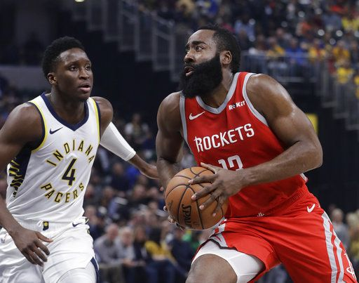 3ca4a7577cb Houston Rockets  James Harden goes to the basket against Indiana Pacers   Victor Oladipo during