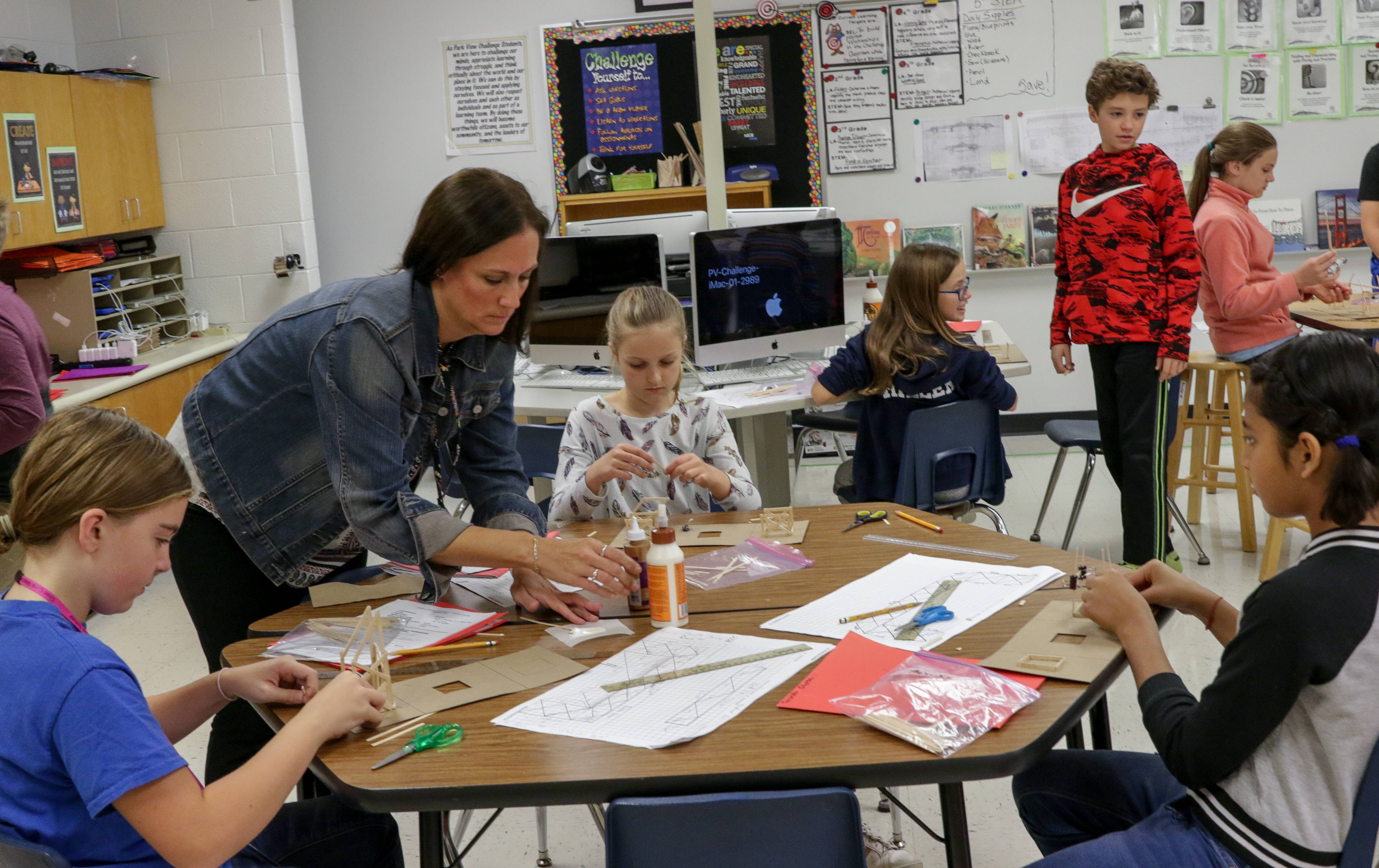 Teacher Jessica Bainter helps the fifth-grade challenge class make bridges at Park View Elementary in Glen Ellyn Elementary District 89, where voters on Tuesday authorized a tax increase for operating expenses.