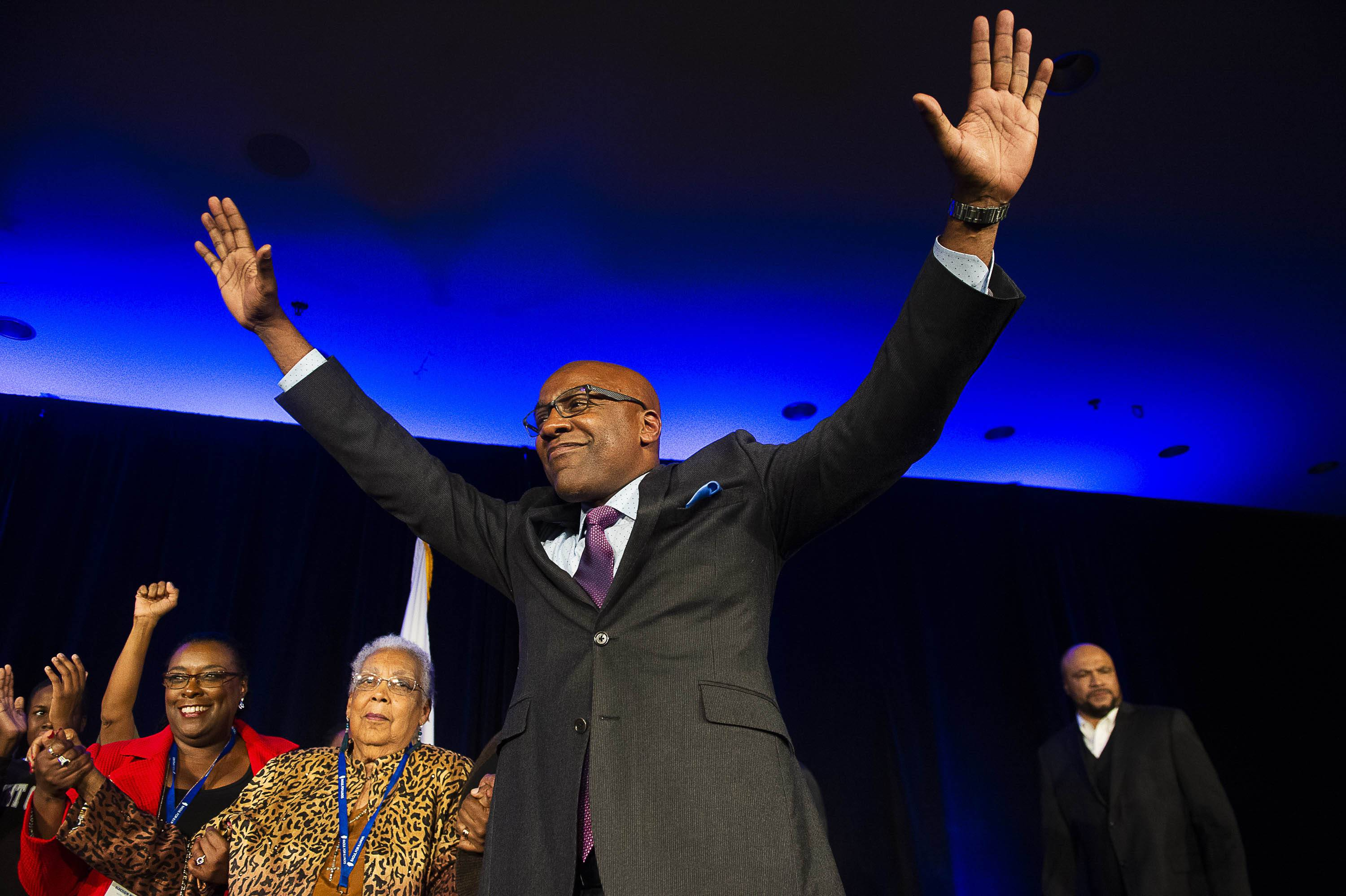 Kwame Raoul gets on stage to address the crowd during his election night party, Tuesday, Nov. 6, 2018, in Chicago. | Tyler LaRiviere/Sun-Times