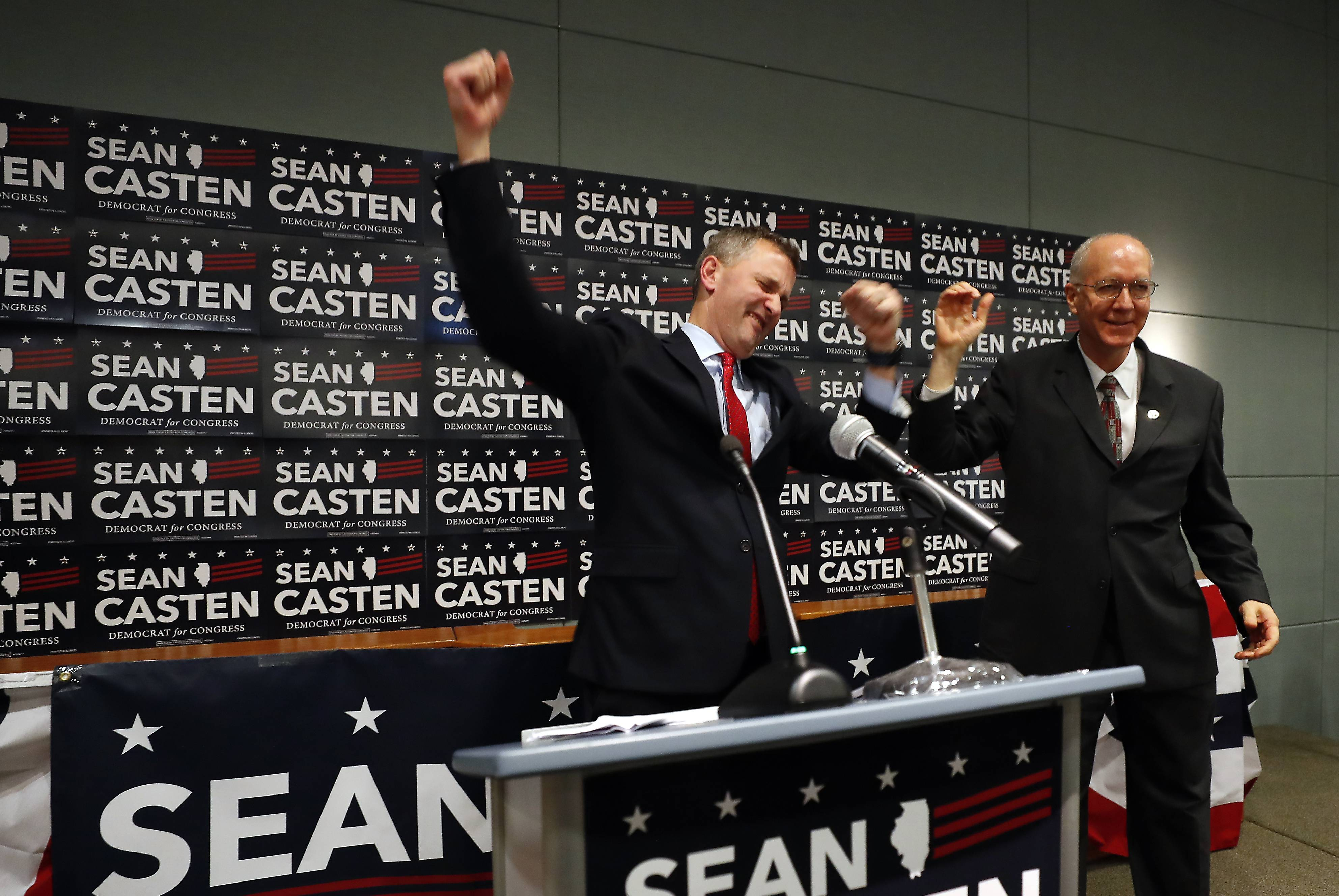 Democrat Sean Casten celebrates with 11th District U.S. Rep. Bill Foster Tuesday after the political newcomer unseated longtime Republican incumbent Peter Roskam to win the 6th District seat in Congress.