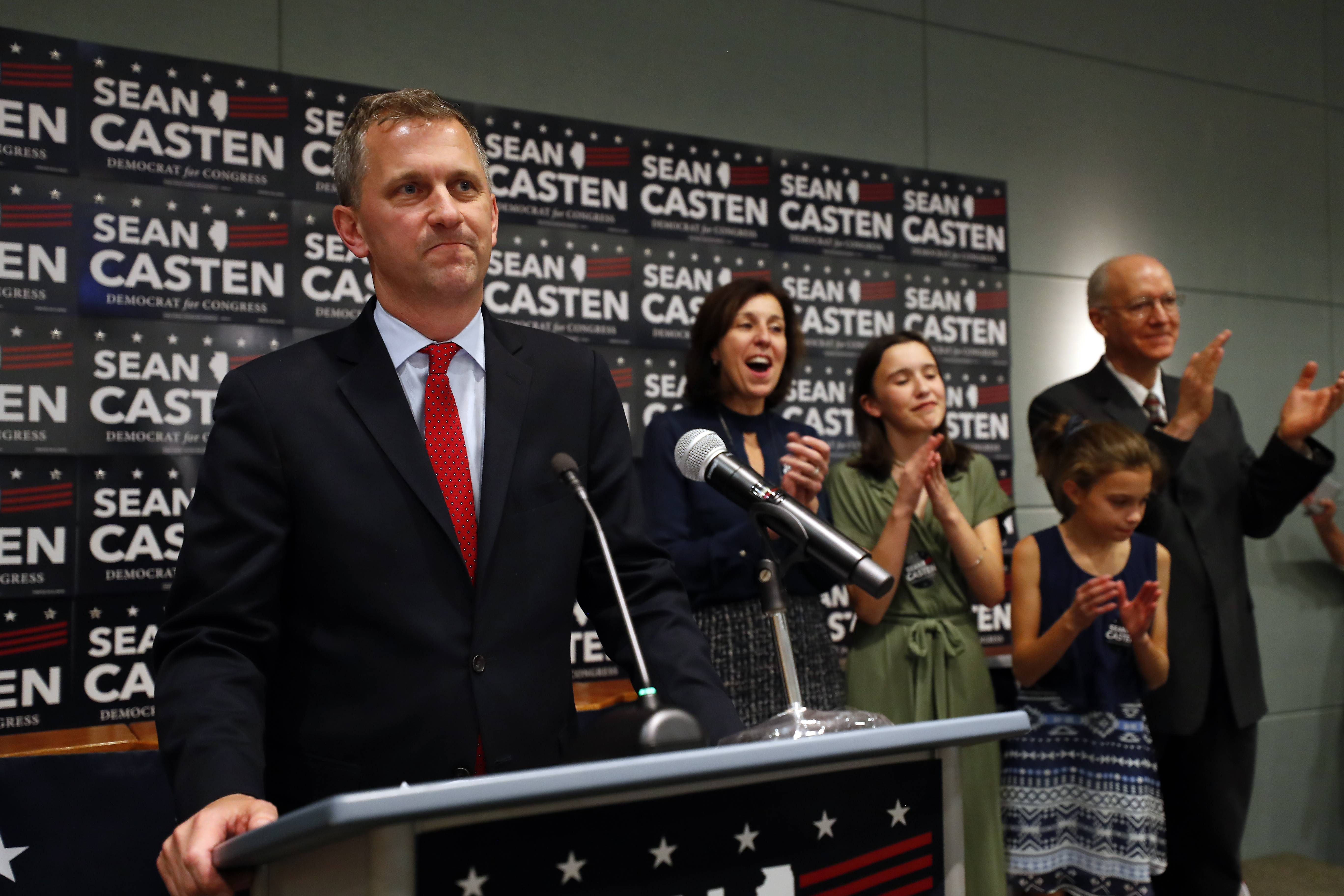 Downers Grove Democrat Sean Casten celebrates on stage with his family Tuesday during an election night party in Warrenville. There, he claimed victory over 6th District incumbent Republican Rep. Peter Roskam of Wheaton.