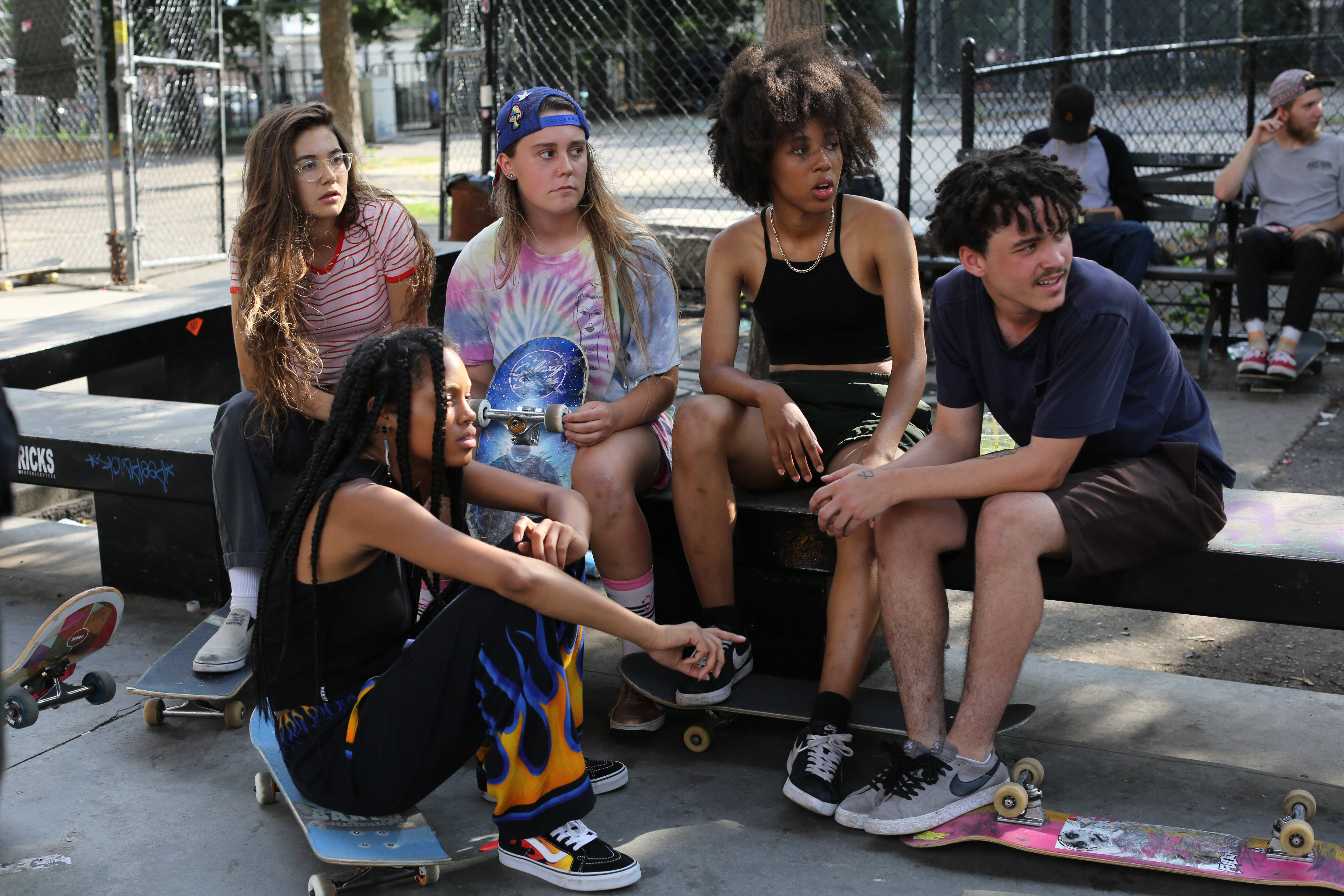 "Rachelle Vinberg, left, Ajani Russell, Nina Moran, Dede Lovelace and Alexander Cooper star in ""Skate Kitchen."""