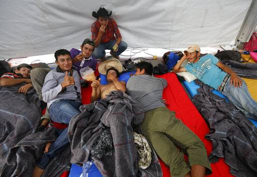 Central American migrants, part of a caravan hoping to reach the U.S. gets settled in a shelter at the Jesus Martinez stadium, in Mexico City, Monday, Nov. 5, 2018. Thousands of Central American migrants have arrived at the stadium, still hundreds of miles away from their goal of reaching the U.S. a day before midterm elections in which they unwittingly became a central issue.
