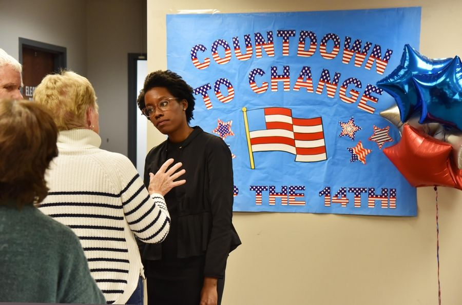 John Starks/jstarks@dailyherald.comLauren Underwood talks with volunteers and supporters of her campaign for the 14th Representative District at her headquarters in St. Charles Wednesday.