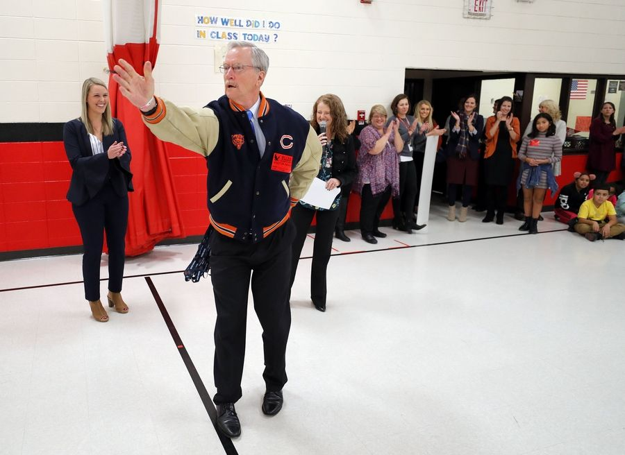 George McCaskey, chairman of the Chicago Bears, is introduced at an all-school assembly Wednesday at Ellis Elementary school in Round Lake Beach. McCaskey was on hand to help present $20,000 to the school.