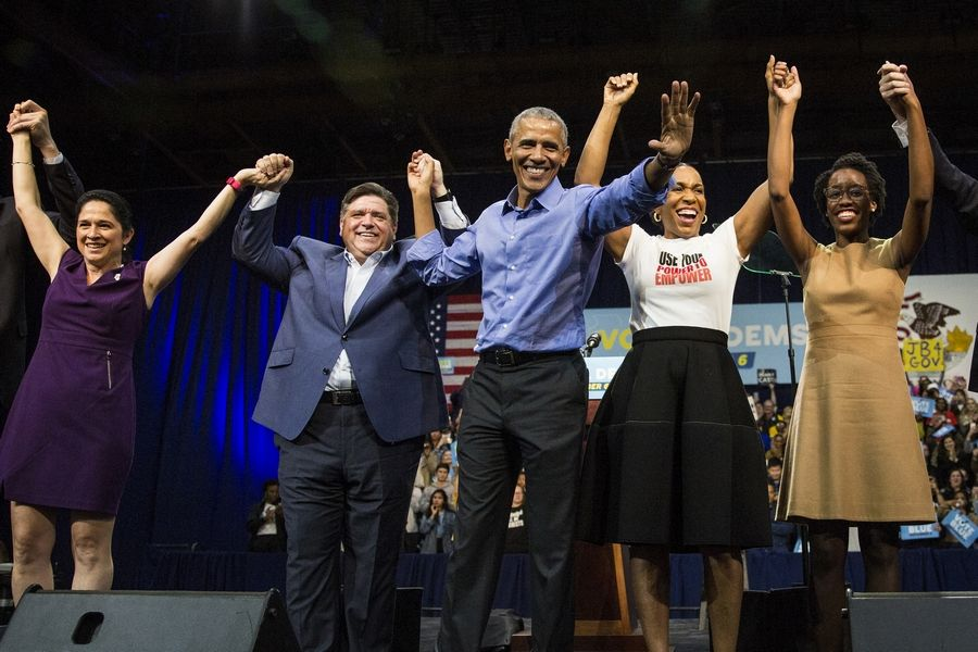 Former President Barack Obama, center, headlined a pre-election rally Sunday at the University of Illinois at Chicago. Appearing with him, all victors on Election Day, are Illinois Comptroller Susana Mendoza, from left, Gov.-elect J.B. Pritzker, Lt. Gov.-elect Juliana Stratton and new U.S. Rep. Lauren Underwood.