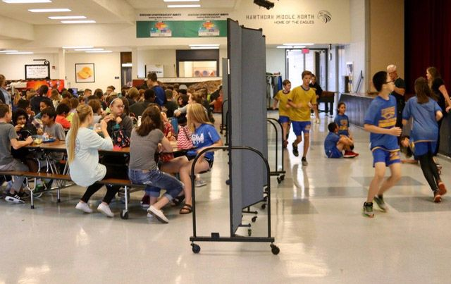 Students share a common space for lunch and gym class at Hawthorn Middle School North in Vernon Hills. Alleviating crowding there is a priority in pending building plans.