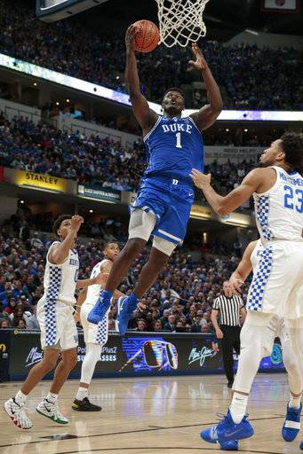Duke forward Zion Williamson (1) shoots in front of Kentucky forward EJ Montgomery (23) during the first half of an NCAA college basketball game at the Champions Classic in Indianapolis on Tuesday, Nov. 6, 2018.