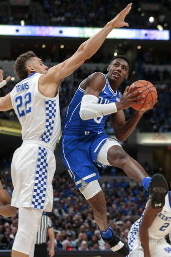 Duke forward RJ Barrett (5) shoots around Kentucky forward Reid Travis (22) during the first half of an NCAA college basketball game at the Champions Classic in Indianapolis on Tuesday, Nov. 6, 2018.