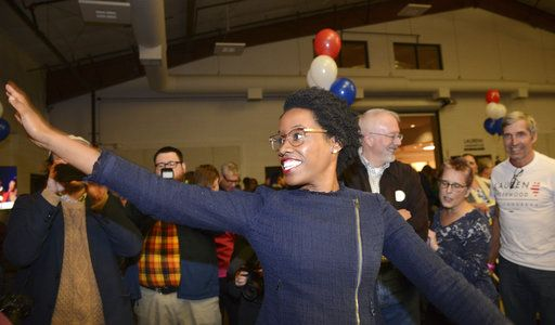 Lauren Underwood, the Democratic candidate in Illinois' 14th District, visits with others at her election night party in St. Charles, Ill., on Tuesday, Nov. 6, 2018. Underwood defeated incumbent Rep. Randy Hultgren. (AP photo / Daily Herald, Rick West)/Daily Herald via AP)