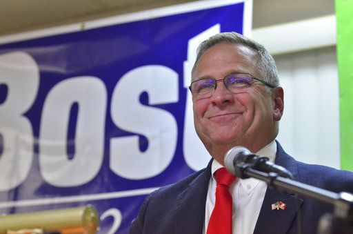 Rep. Mike Bost, R-Ill., smiles as he speaks to supporters during an election night rally at the Elks Lodge in Murphysboro, Ill., Tuesday, Nov. 6, 2018.