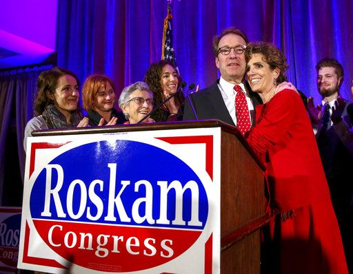 U.S. Rep. Peter Roskam, R-Ill., hugs wife Elizabeth after conceding defeat to Democrat Sean Casten in their 6th District race at his election night party in Wheaton, Ill., on Tuesday, Nov. 6, 2018. (Bev Horne/Daily Herald via AP)