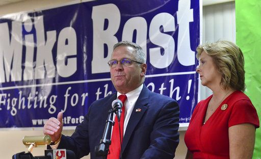 U.S. Rep. Mike Bost, R-Ill., gestures as he speaks to his supporters with his wife, Tracy, beside him during an election night rally at the Elks Lodge in Murphysboro, Ill., Tuesday, Nov. 6, 2018.