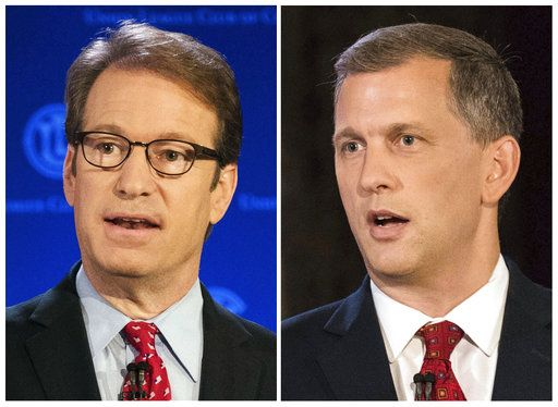 FILE - This combination of July 26, 2018, file photos shows candidates for Illinois' 6th Congressional District race from left, incumbent Republican Rep. Peter Roskam and Democrat Sean Casten. (Max Herman/Chicago Sun-Times via AP, File)/Chicago Sun-Times via AP)