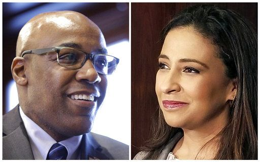FILE - This combination of file photos shows candidates for Illinois attorney general in the November 2018 election from left, Democratic state Sen. Kwame Raoul and Republican Erika Harold.