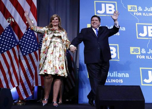 Democratic candidate for governor J.B. Pritzker waves to supporters as he enters the stage with wife M.K. to claim victory in Chicago, Tuesday, Nov. 6, 2018.