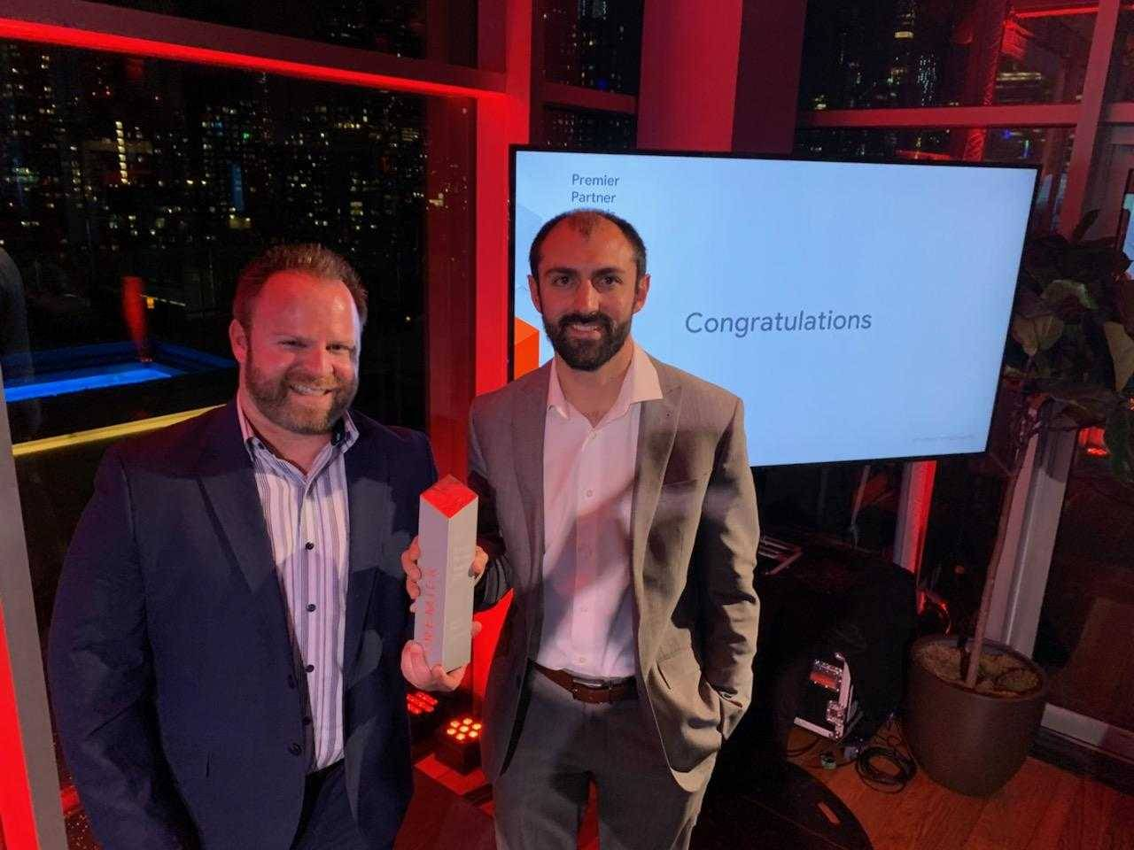 Matt Neely, Vice President of Client Services and Brian Aldrich, Director of Enterprise Search accept Premier Partner Award from Google.Logical Position