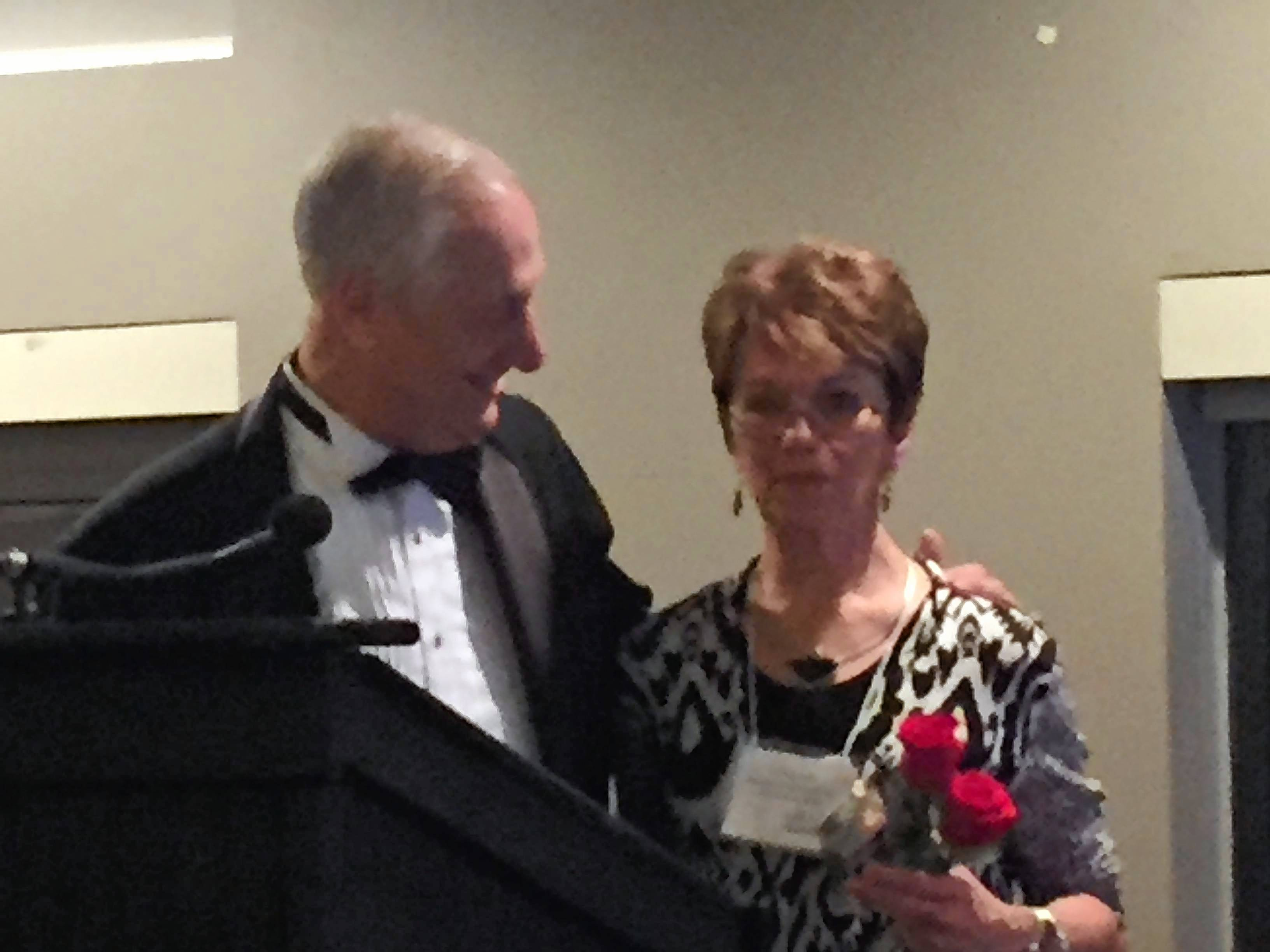 "Scott Lebin of the Geneva Chamber of Commerce presents the Wood Community Service Award to Cheryl ""Cookie"" Olson on Thursday night."