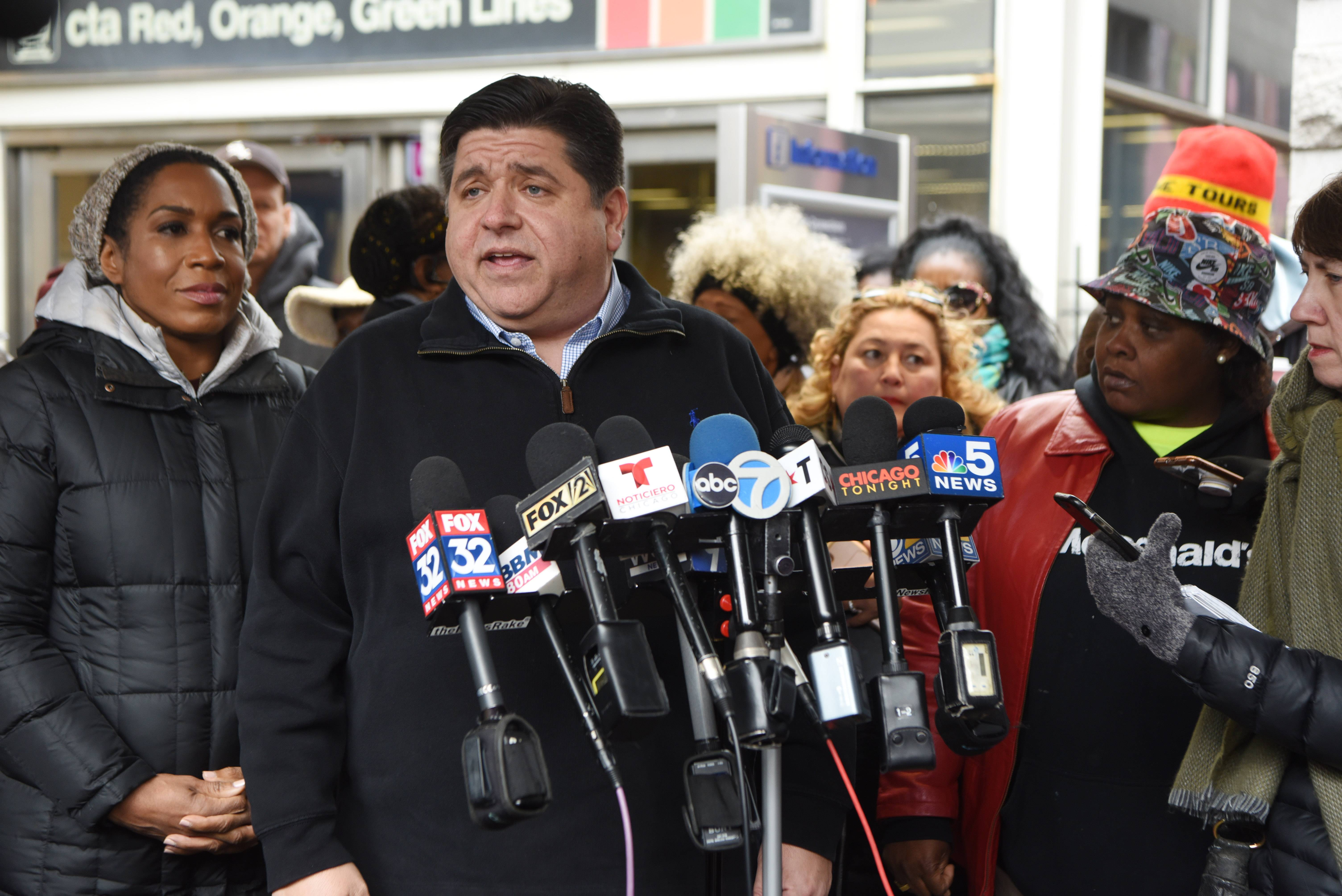 Gov.-elect J.B. Pritzker and running mate Juliana Stratton, left, speak to the media and greet supporters in Chicago Wednesday.
