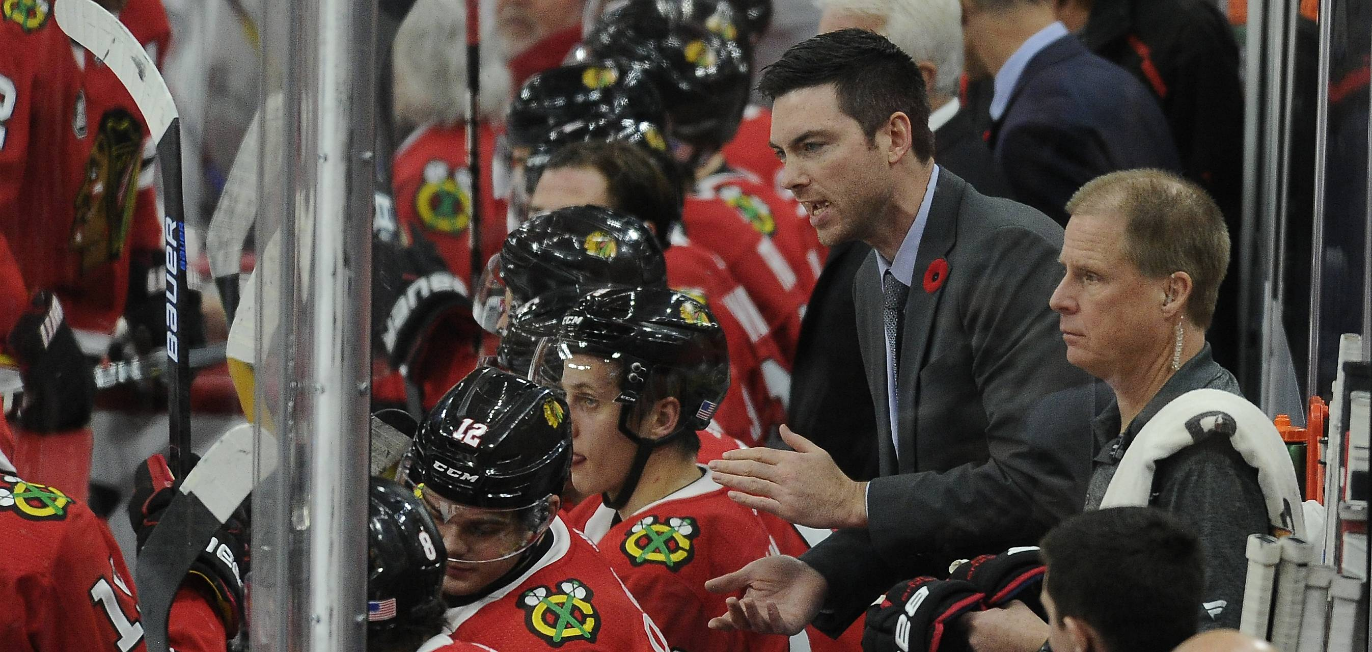 Chicago Blackhawks coach Jeremy Colliton gives advice to his players during the 4-3 loss to the Carolina Hurricanes at the United Center in Chicago. With a new coach behind the bench, the Blackhawks' bad habits remained the same Thursday night.