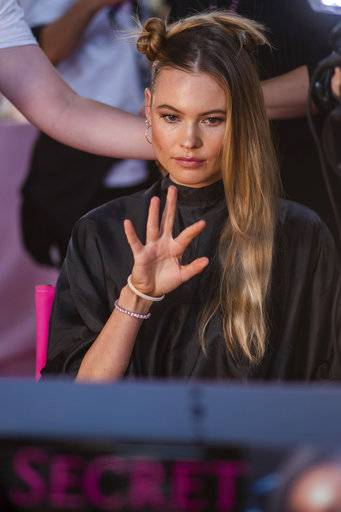Behati Prinsloo appears backstage during hair and makeup at the 2018 Victoria's Secret Fashion Show at Pier 94 on Thursday, Nov. 8, 2018, in New York. (Photo by Charles Sykes/Invision/AP)