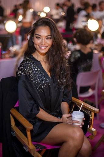 Shanina Shaik appears backstage during hair and makeup at the 2018 Victoria's Secret Fashion Show at Pier 94 on Thursday, Nov. 8, 2018, in New York. (Photo by Charles Sykes/Invision/AP)