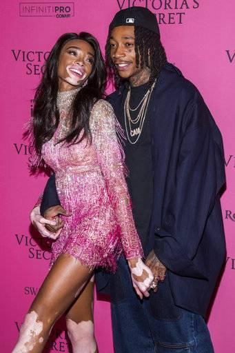 Winnie Harlow and Wiz Khalifa attend the 2018 Victoria's Secret Fashion Show after-party at Pier 94 on Thursday, Nov. 8, 2018, in New York. (Photo Charles Sykes/Invision/AP)